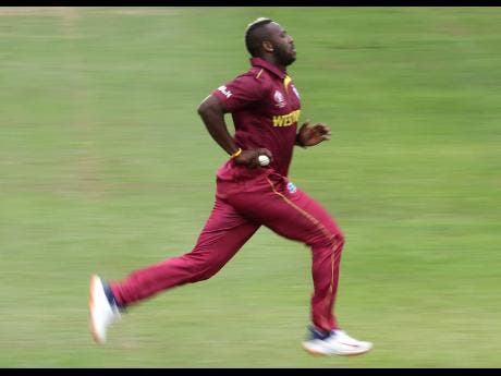 West Indies' Andre Russell runs to bowl a delivery during the Cricket World Cup warm up match between West Indies and South Africa.