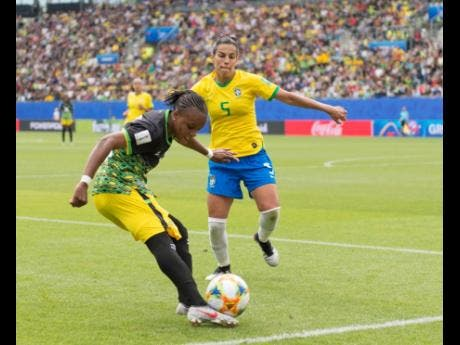 Trudi Carter attempts to cross a ball in Jamaica's opening match of the 2019 FIFA Women's World Cup against Brazil.