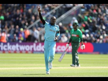 England's Jofra Archer celebrates bowling out Bangladesh's Soumya Sarkar during the ICC Cricket World Cup group-stage match at the Cardiff Wales Stadium in Cardiff last Saturday.