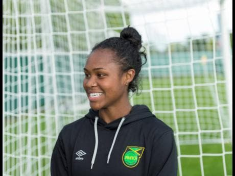 Grey has a lot to smile about these days after being recalled to the Reggae Girlz squad taking part in the FIFA Women's World Cup to replace the injured Kayla McCoy.