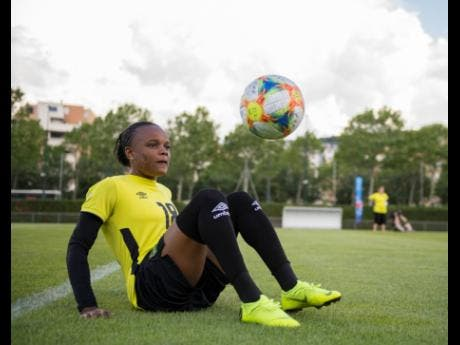 Trudi Carter shows off her 'keep it up' skills yesterday ahead the Reggae Girlz Group C encounter against Australia today.