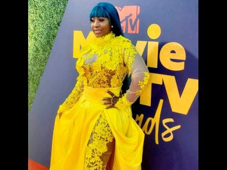 Dancehall queen Spice reigns in yellow at the MTV Movie and TV Awards.