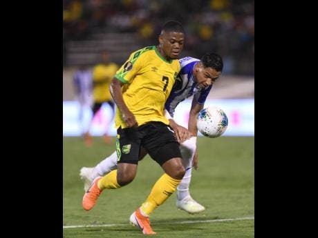 Debutant Leon Bailey gets away from Honduran defender Emilio Izaguirre in the Jamaica's first Gold Cup match at home.