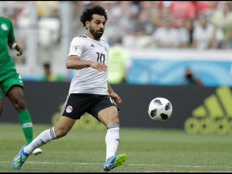 In this June 25, 2018 file photo, Egypt's Mohamed Salah chases the ball during the Group A match between Saudi Arabia and Egypt at the 2018 World Cup at the Volgograd Arena in Volgograd, Russia.