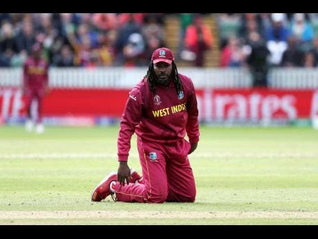 West Indies' Chris Gayle sinks his knees in the field during the Cricket World Cup match against Bangladesh at The Taunton County Ground, Taunton, southwest England, on Monday.
