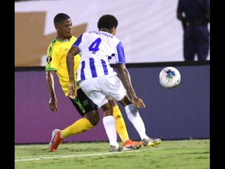 Leon Bailey executes a sublime pass beyond the comprehension of Honduran Henry Figueroa to set up Jamaica's opening goal in their opening match of the 2019 Gold Cup.