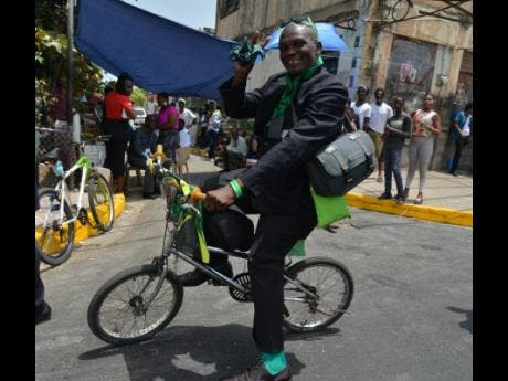 West Kingston resident Everton Maitland arrives for the funeral of Edward Seaga.