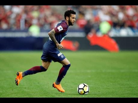In this file photo dated  Tuesday, May 8, 2018, PSG's Dani Alves runs with the ball during the French Cup final against Les Herbiers at the Stade de France stadium in Saint-Denis, outside Paris.