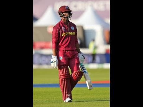 West Indies' Shimron Hetmyer leaves the field after being dismissed during the Cricket World Cup match between New Zealand and West Indies at Old Trafford in Manchester, England, last Saturday.