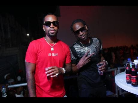 American rapper Safaree Samuels (left), who flew out for the event, spends the night chillin' with Bounty Killer.