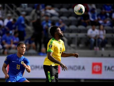 Jamaica midfielder Ricardo Morris, right, heads the ball next to Curacao defender Jurien Gaari during the first half of a CONCACAF Gold Cupr match yesterday.