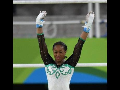 Toni-Ann Williams raises her arms after completing one of her routines at the Rio de Janeiro Olympic Games in 2016.