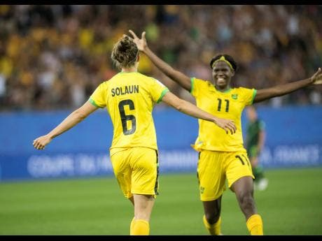 Havana Solaun celebrates with Khadija Shaw (right) moments after scoring the team's first goal in the FIFA Women's World Cup 2019 at Stade des Alpes in Grenoble, France, on Tuesday, June 18. Jamaica lost 4-1.