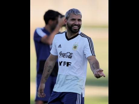 Sergio Aguero smiles during a training session of Argentina's national football team at the Cruzeiro training centre in Belo Horizonte, Brazil, yesterday.