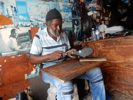 Kenneth Lewis has been repairing shoes for 45 years.