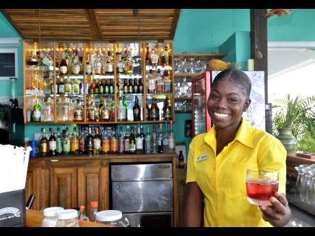 Luna Sea Inn employee Kayon serves up a refreshing drink with a smile.