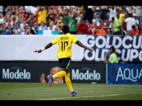 Mattocks celebrates after scoring Jamaica's only goal against Panama to put his team in the Gold Cup semi-final.