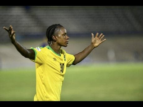Mattocks raises his arms during a Nations League match against The Cayman Islands at the National Stadium on September 9, 2018.