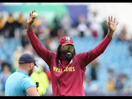 West Indies' Chris Gayle holds the ball as he leaves the ground after their win over Afghanistan in the Cricket World Cup match at Headingley in Leeds, England yesterday.