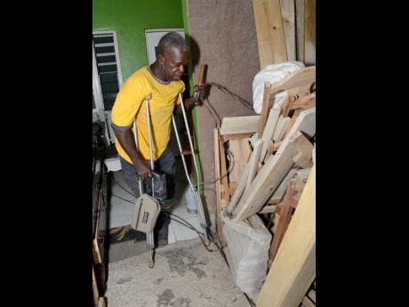Douglas Lindo, a one-legged carpenter, at his workshop in Seaview Gardens, West St Andrew.