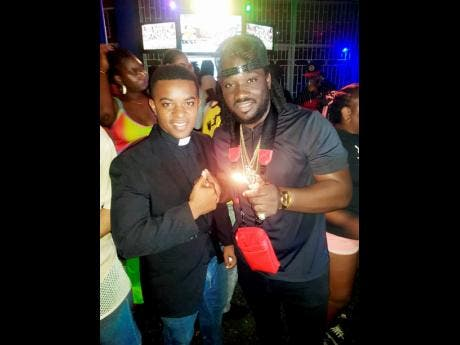 Self-proclaimed pastor Stephen Blake (left) and recording artiste I-Octane at popular street dance Uptown Mondays.