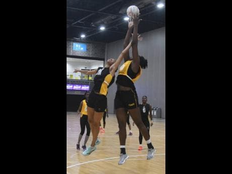 National defender Shamera Sterling (left) attempts a block on teammate Jhaniele Fowler during a training session yesterday, ahead of tomorrow's game against Fiji at the Netball World Cup in Liverpool, England. Photo courtesy of Collin Reid, Courts Jamaica, Jamaica Tourist Board, Alliance Investments, Dairy Industries and Supreme Ventures.