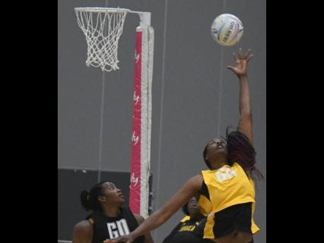 Photos courtesy of Collin Reid, Courts Jamaica, Jamaica Tourist Board, Alliance Investments, Dairy Industries, and Supreme Ventures. National goal attack Romelda Aiken (left) jumps for a high ball during the Sunshine Girls' training session on Wednesday, ahead of today's Netball World Cup game against Fiji in Liverpool, England.