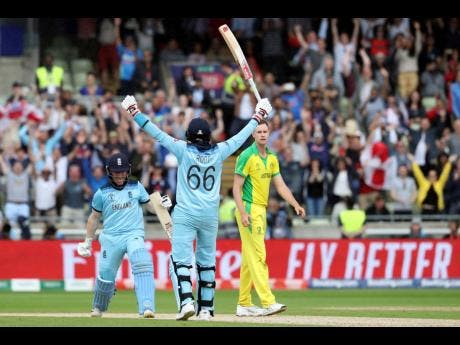 England captain Eoin Morgan (left) celebrates with teammate Joe Root after winning their ICC World Cup semi-final match against arch-rivals Australia at Edgbaston in Birmingham, England, yesterday.