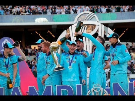 England's cricketers douse captain Eoin Morgan with champagne after winning the Cricket World Cup final.