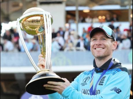 England captain Eoin Morgan lifts the trophy after winning the Cricket World Cup final match between England and New Zealand at Lord's cricket ground in London yesterday.