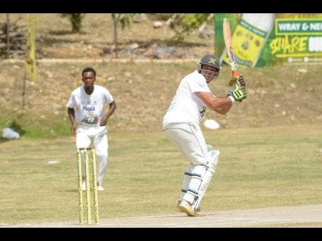 Junction Ballards Valley's Ramon Davis plays a flick shot against May Pen Lions yesterday as the SDC Wray & Nephew T20 Community Cricket stops at Sir P's Oval in Clarendon yesterday.
