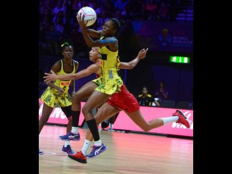 Jamaica's Shanice Beckford gets to the ball ahead of England's Serena Guthrie as the Sunshine Girls suffered their second defeat of the 2019 Netball World Cup.