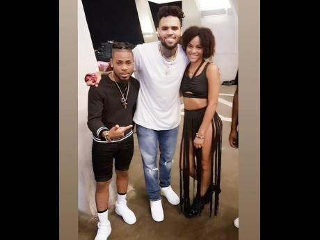 Dancers Domani Black and his wife Jay share a moment with superstar Chris Brown at a recent video shoot.