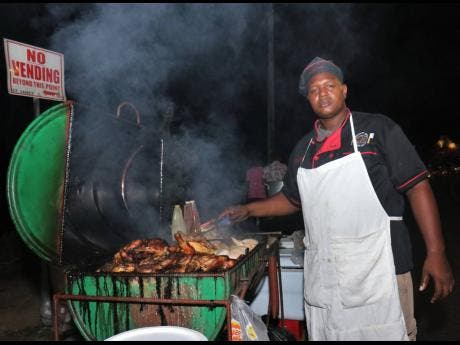 Photo By Adrian Frater Pan chicken vendor Dwayne 'Sugar' Senior is looking forward to good sales this Sumfest week, now that downtown Montego Bay has been designated a special entertainment zone.
