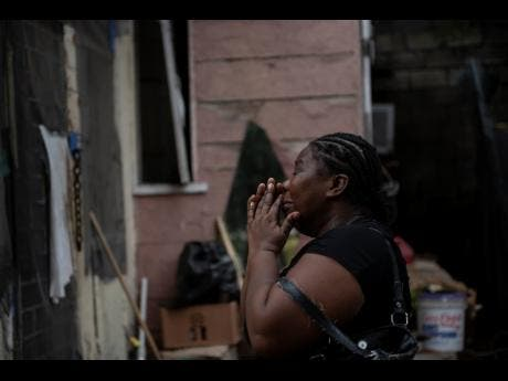 A resident is overcome with emotion as she fears the potential damage to her home.
