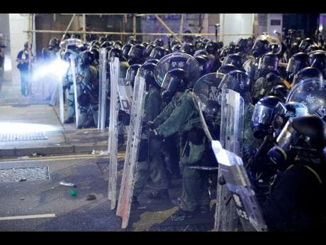 Riot police officer form up during a confrontation with protesters in Hong Kong yesterday.