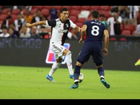 Juventus' Cristiano Ronaldo (left) in action against Tottenham Hotspur's during their International Champions Cup match in Singapore on Sunday. (AP Photo/Danial Hakim)