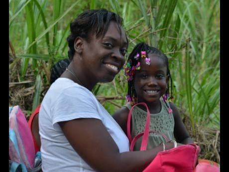 Allia Henry and her daughter Chevene Henry came to  watch the annual Donkey Race held at Top Hill in St Catherine on Emancipation Day.