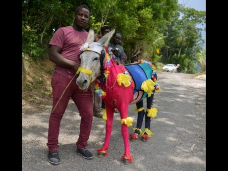 Dwayne Jones poses with his donkey, Pablo, which was adjudged the best dress donkey at the races.