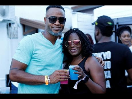 Barbados Tourism Marketing's Corey Garrett and Alison Alleyne join in on the cocktail fun at Medz last Saturday, August 2.