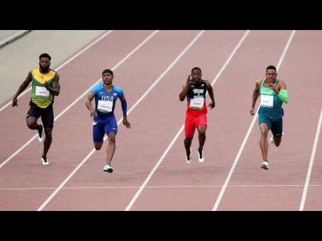 Michael Rodgers of the United States runs to win the men's 100m final during the athletics at the Pan American Games in Lima, Peru, on Wednesday. Paulo Andre of Brazil won silver, Cejhae Greene of Antigua and Barbuda won bronze and Rasheed Dwyer of Jamaica finished fifth.
