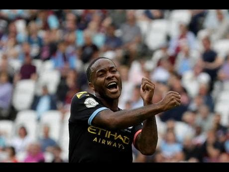 Manchester City's Raheem Sterling celebrates after scoring his side's fifth goal during the English Premier League match between West Ham United and Manchester City at London Stadium in London last Saturday.
