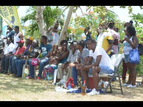 Spectators take in the action as Orange Hill beat White River in the semi-final of the SDC/ Wray & Nephew National Community T20 Cricket Competition on Sunday.