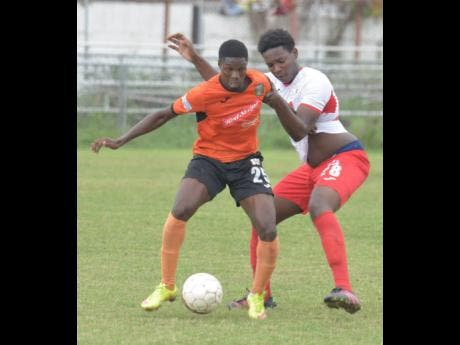 Former Tivoli Gardens player Colorado Murray (left) getting the better of Kurt Thomas (right) from Boys' Town in a Red Stripe Premier League in 2017.