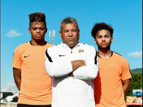Phoenix Academy founder Craig Butler (centre) and standout players Leon Bailey (left) and Kyle Butler, his sons.