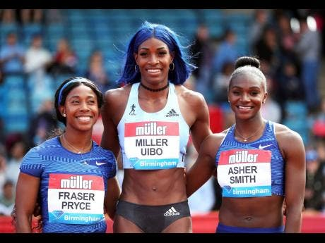 The Bahamas Shaunae Miller-Uibo (centre) poses after winning the women's 200m final at the Birmingham leg of the Diamond League alongside second-place Dina Asher-Smith of  Great Britain (right) and third-place Shelly-Ann Fraser-Pryce of Jamaica.