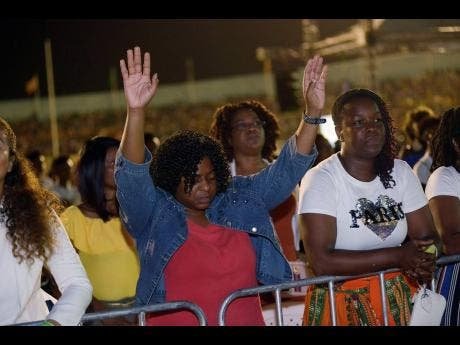 Patrons worship during Unity in the City on Saturday. The organisers believe that people were blessed at the show.