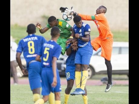 Goalkeeper Shaquan Davis (right), of Hydel High, leaps into action to save a header in the ISSA/Digicel Walker Cup final against Excelsior High at Stadium East in Kingston on Wednesday, November 14, 2018.