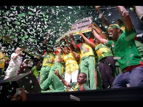 Gayle Cricket Club celebrate after claiming the 2019 SDC/ Wray & Nephew National T20 community cricket title yesterday.