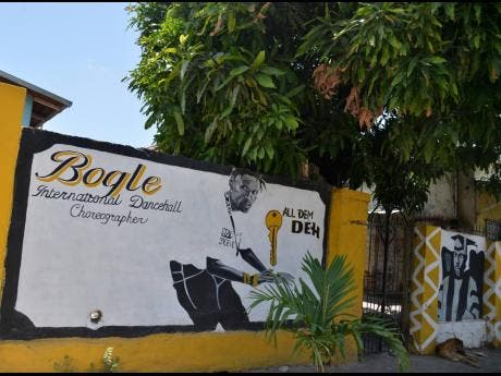 A mural at the gate of the house Bogle once callled home.